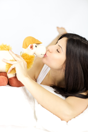 Beautiful woman kissing camel plush  Stock Photo - 24918334