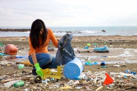 Young activist volunteering on the beach Stock Photo
