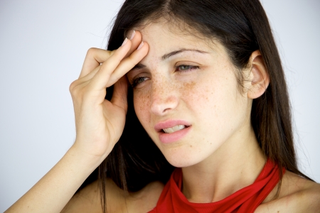 Woman with very strong headache suffering