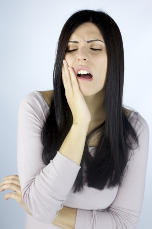 Woman suffering strong teeth ache photo