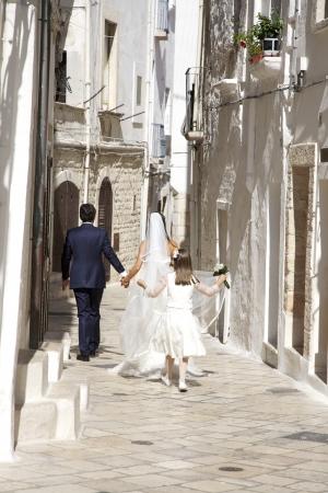 Happy married couple walking on street photo