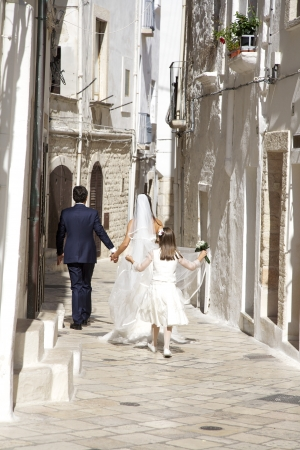 Happy married couple walking on street photo