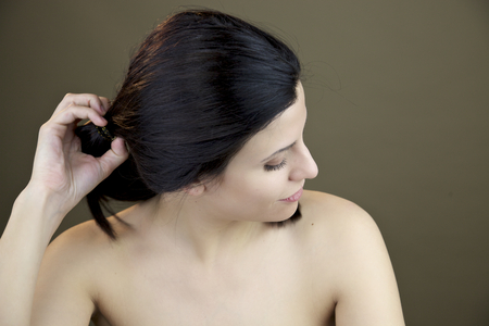 Gorgeous naked woman takingi out ponytail  photo