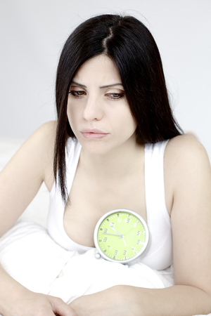 Depressed woman with heart disease feeling sad photo