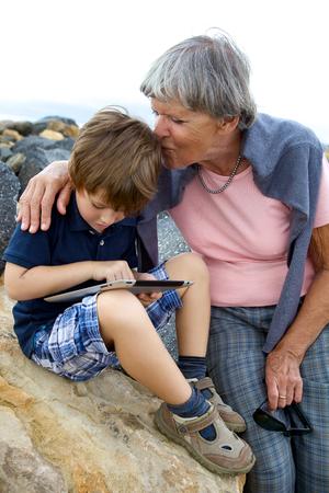 Happy grandmother in love hugging child photo