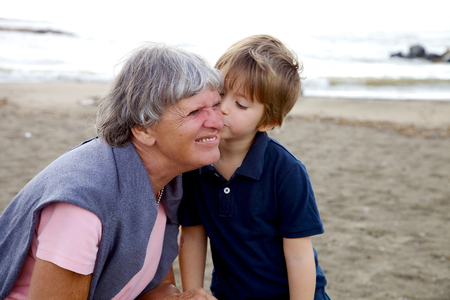 Loving relationship between grandson and grandmother photo