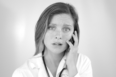 Portrait of desperate woman doctor shocked by bad news photo