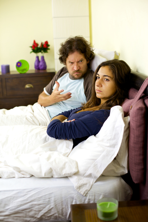 Couple in trouble bad relationship in bed photo