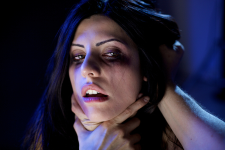Horrible domestic violence on beautiful woman photo