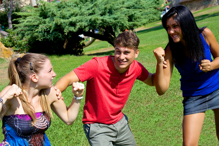 Handsome man having fun about two girls ready to cat fight for hime photo