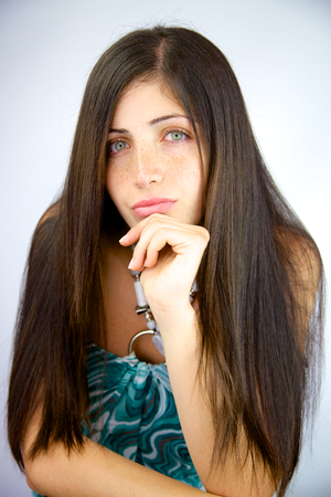 Gorgeous straight long hair of woman with green eyes and freckles photo