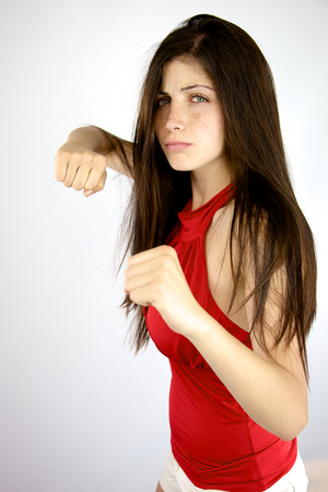gorgeous female model with fist in action photo