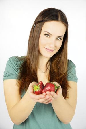 Cute woman holding fresh strawberries photo