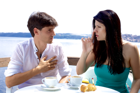 Angry woman telling husband to be quiet and not talk Stock Photo