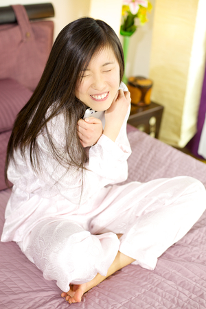 Cute asian woman hugging tablet photo