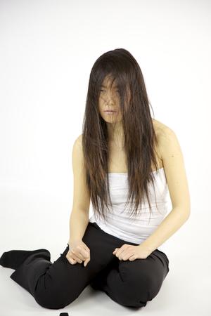 Sad depressed woman with bad hair look photo