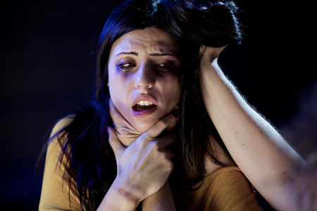 adult rape: Scared woman suffering during domestic violence Stock Photo