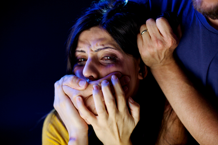battered woman: Depressed woman getting abused by man