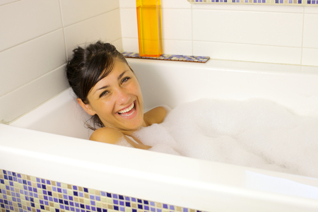 Cute fresh girl smiling happy taking a bath photo