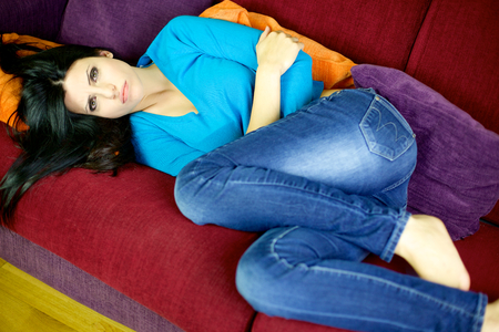 Gorgeous lady with strong menstruation pain photo