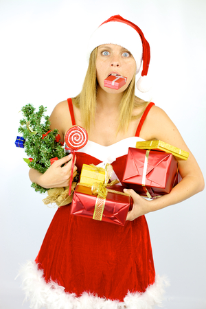 Funny santa claus woman having problems with too many gifts photo