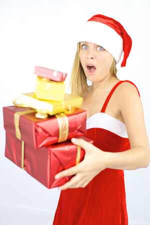 Cute blond woman santa claus fearing to loose gifts photo