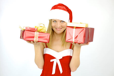 Cute blond woman santa claus smiling with packages for Christmas photo