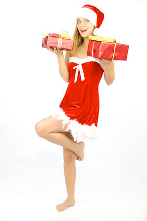 Cute woman santa claus with red gifts photo