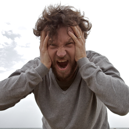 Desperate man shouting asking for help Stock Photo