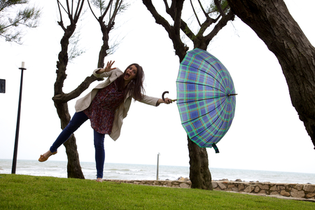 Woman flying away with the wind photo