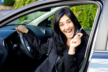 succesful woman: Succesful woman with brand new car Stock Photo
