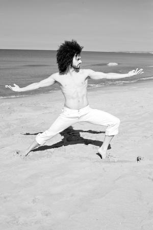Cool shirtless man doing yoga black and white photo