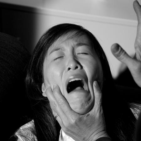 Sad asian woman crying desperate Stock Photo