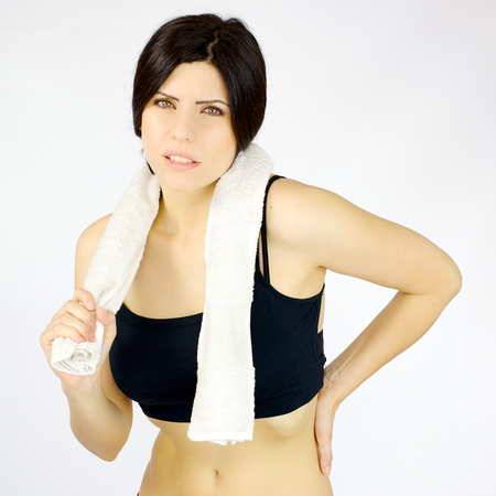back ache: Woman after sport feeling ache on back