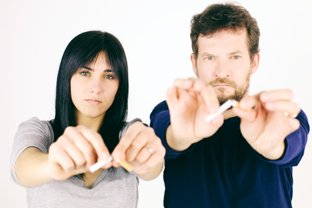 Serious couple deciding to stop smoking Stock Photo