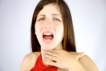 Sad woman feeling sick without voice photo