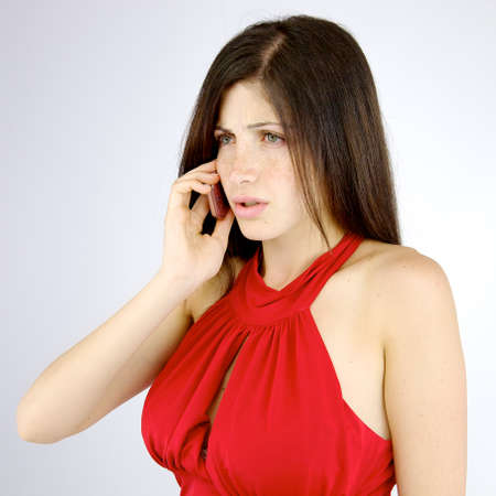 Unhappy young woman fighting on the phone photo