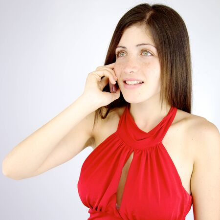 Cute girl with freckles on the phone talking photo