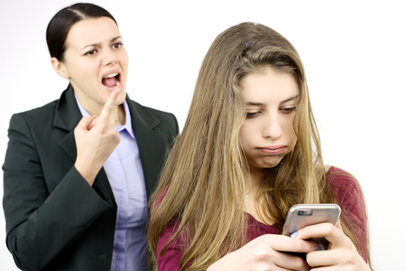 Teenager addicted with cell phone not listening mother photo