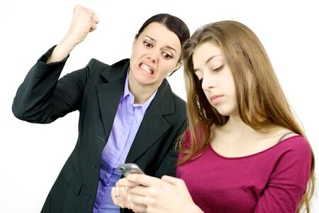 Mother crazy and angry about daughter playing with cell phone photo