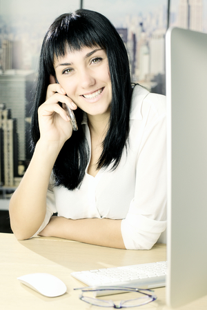 Cute lady smiling looking camera in office Stock Photo