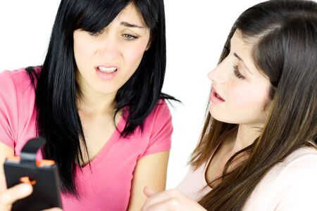 bad feeling: Unhappy girls feeling bad reading news on cell phone isolated