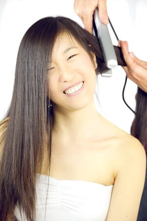 chinese american: Cute Chinese American girl at hairstylist salon
