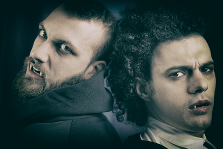 vampire teeth: Angry and sad vampires looking camera