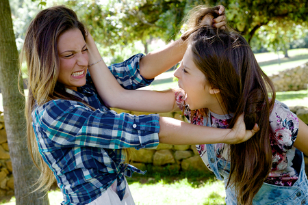 pulling beautiful: Unhappy girls fighting angry
