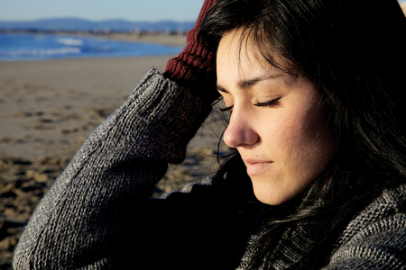 heartbroken: Young woman feeling pain thinking about lost love Stock Photo