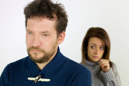 divorce: Unhappy man after fight with girlfriend in background Stock Photo