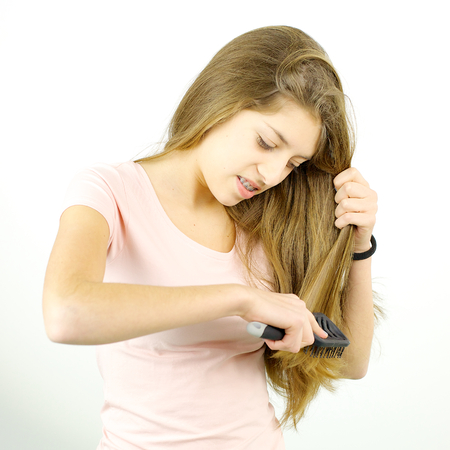 rapunzel: unhappy teenager brushing hair