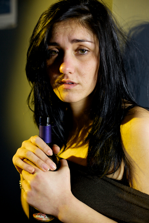 addicted: Sad woman addicted to alcohol Stock Photo