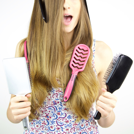 Funny expression of woman with comb in hair